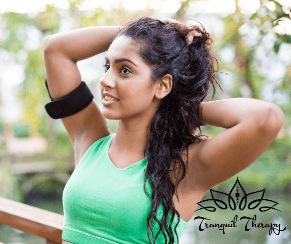 Woman with long brown hair is resting after a workout